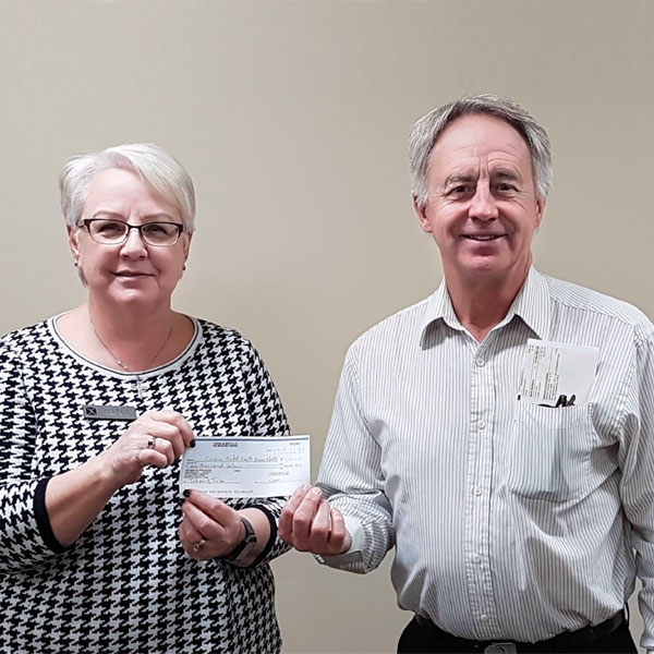 Canadian Mental Health Association ANWR Executive Director Debra Stoner accepting a cheque from Medicine Shoppe owner Curtis Crough.